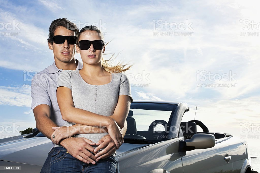 Couple Embrace in Front of Car royalty-free stock photo
