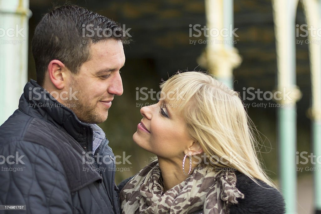 Couple embrace looking into each others eyes stock photo