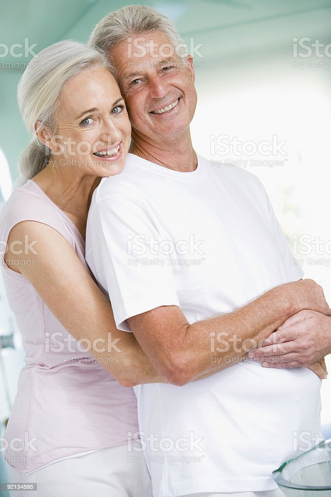 Couple embracing at a spa and smiling royalty-free stock photo