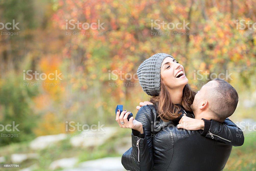 couple embracing in autumn mountain stock photo