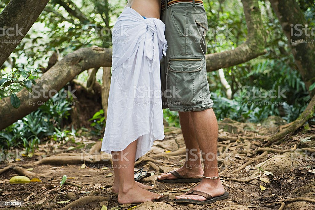 Couple embracing in forest stock photo