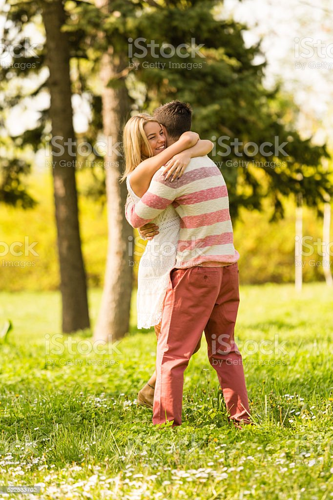 Couple embracing in park stock photo