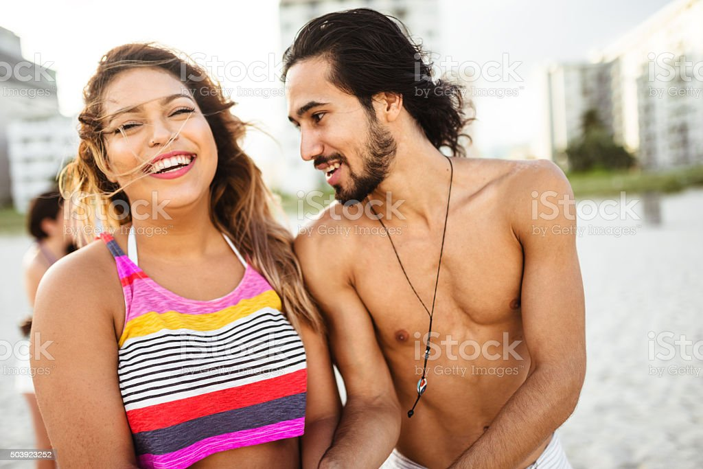 couple embracing on the beach for summer stock photo
