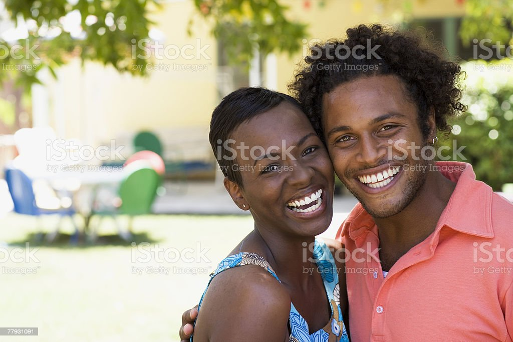 Couple embracing outdoors smiling royalty-free stock photo