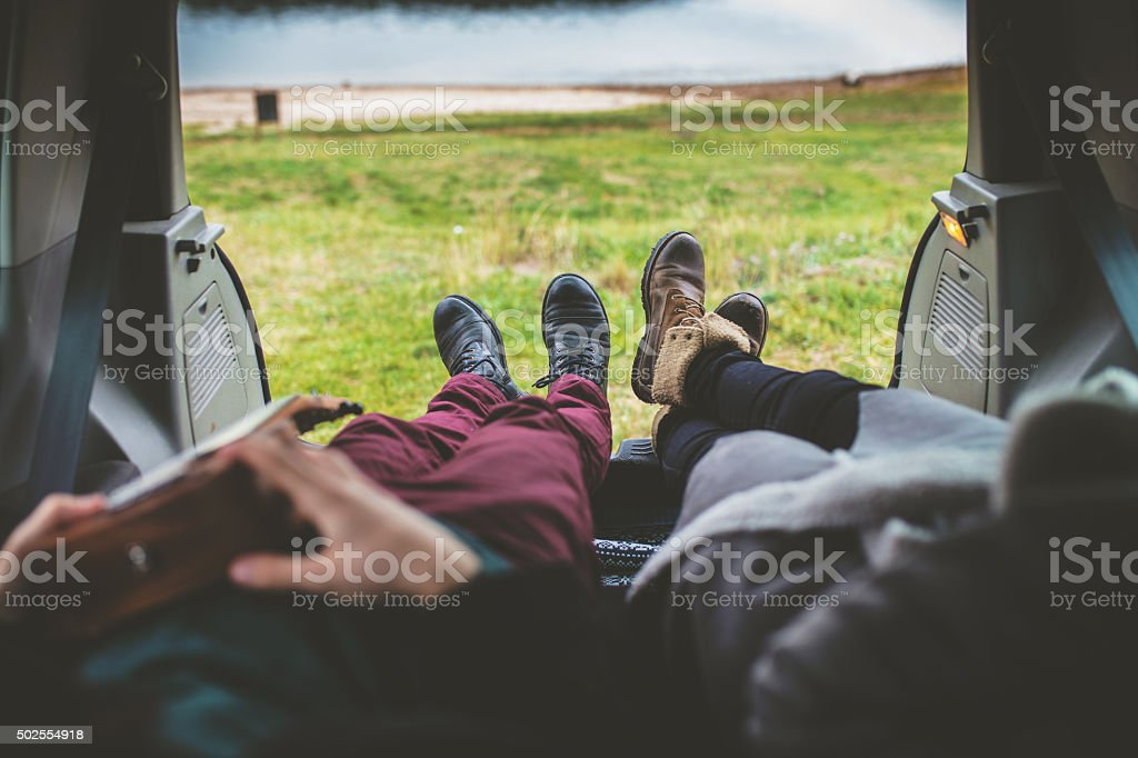 Couple enjoy look on beautiful nature from car stock photo