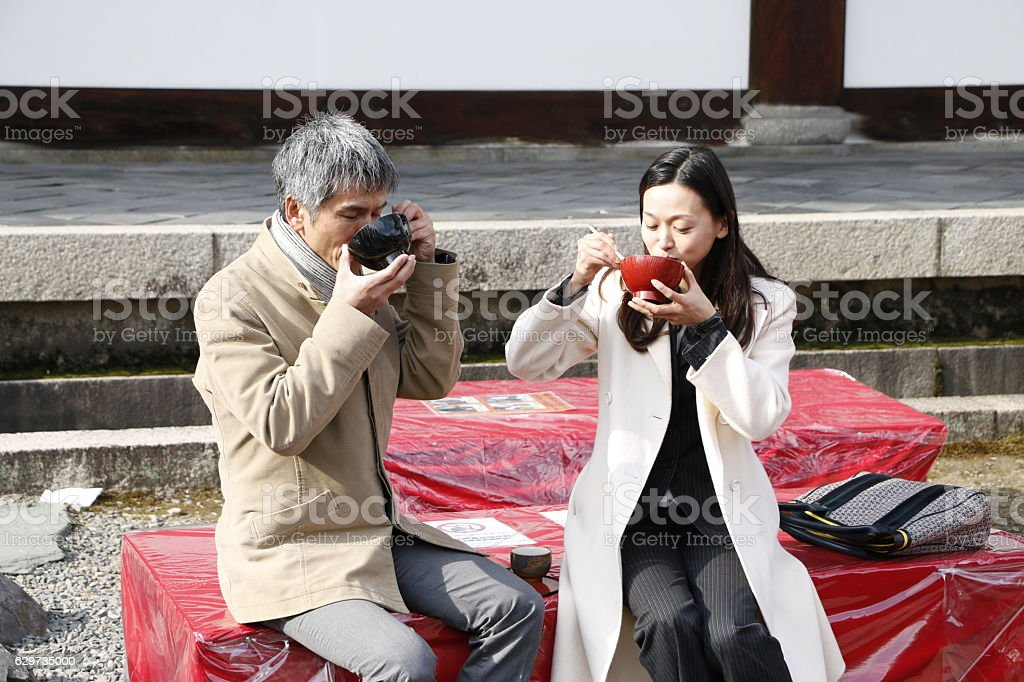 Couple enjoy Red bean soup in Kyoto stock photo
