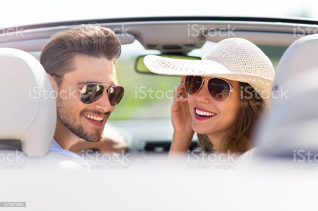 Couple enjoying a drive in a convertible stock photo