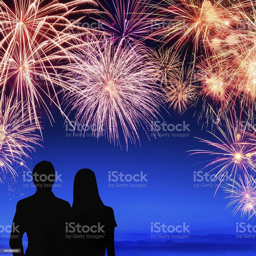 Couple enjoying a fireworks display royalty-free stock photo