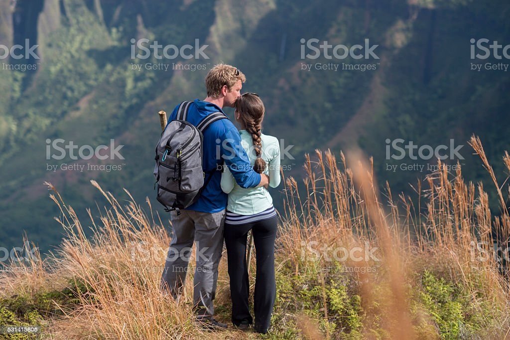 Couple Enjoying a Hike on Their Honeymoon stock photo