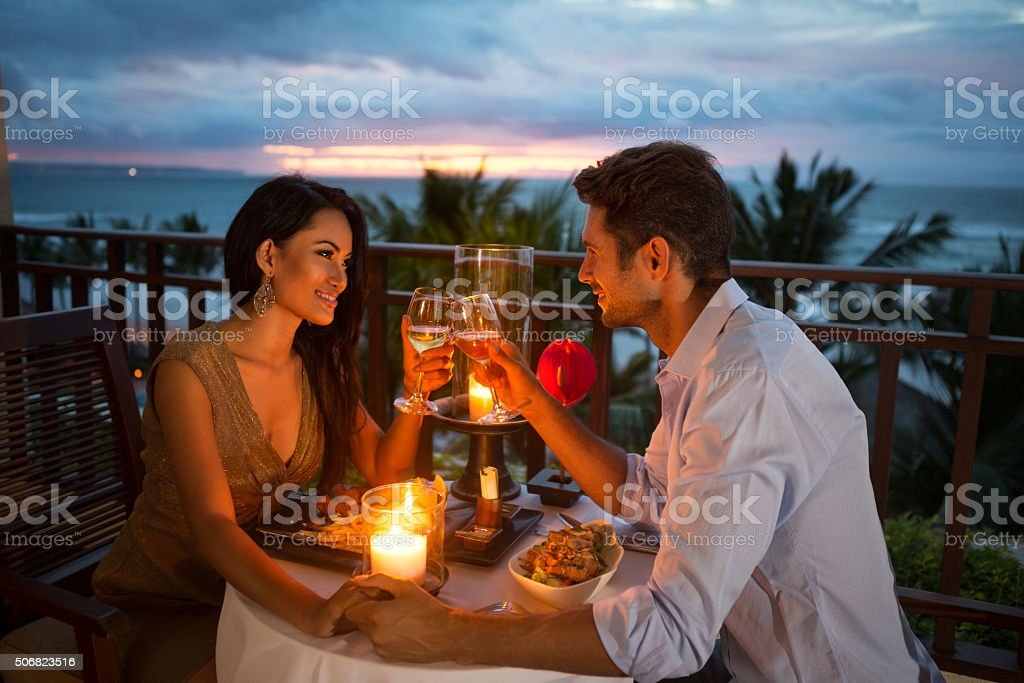 couple enjoying a romantic dinner by candlelight stock photo