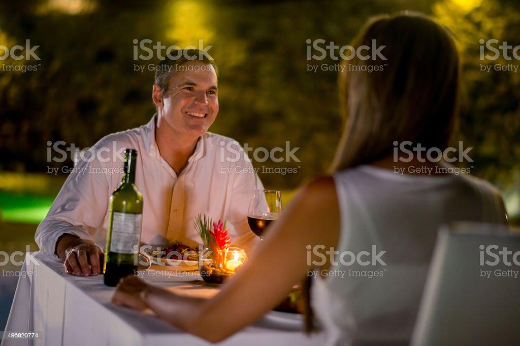 Couple enjoying a romantic dinner stock photo