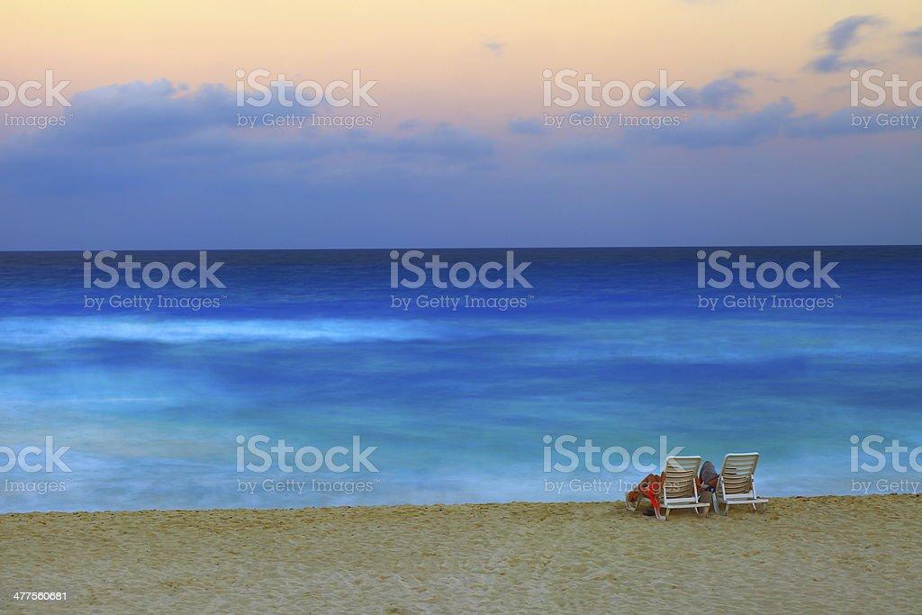 Couple enjoying a romantic sunset on the Caribbean beach royalty-free stock photo
