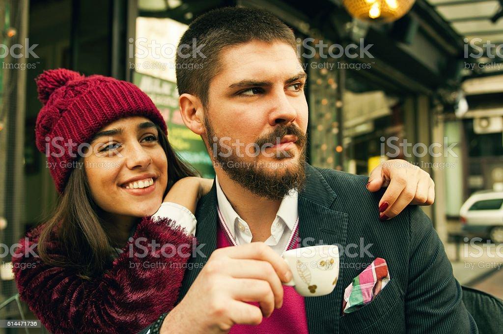 Couple enjoying at coffee bar stock photo