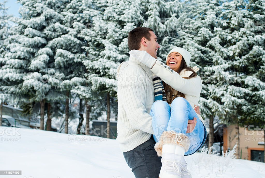 Couple enjoying at sunny winter day, royalty-free stock photo