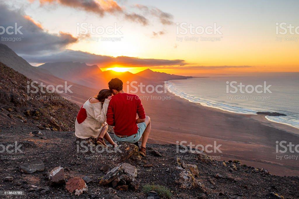 Couple enjoying beautiful sunset on Fuerteventura island stock photo