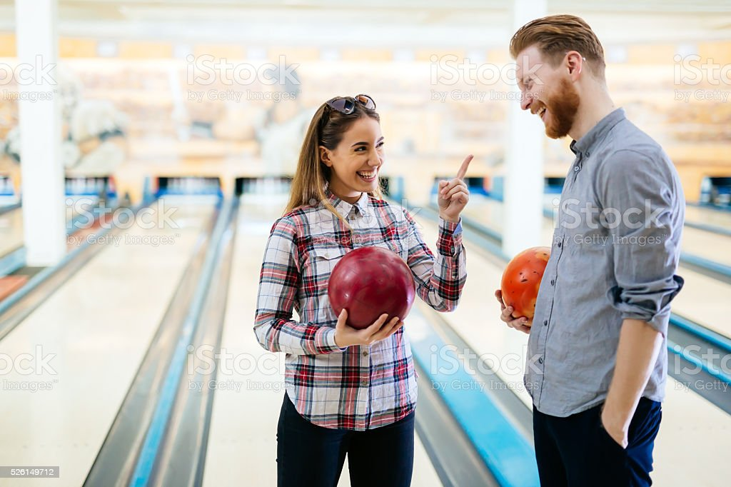 Couple enjoying bowling together stock photo