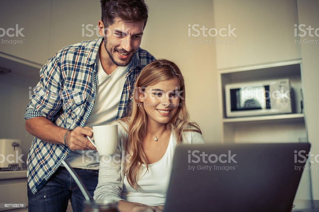 Couple enjoying breakfast stock photo