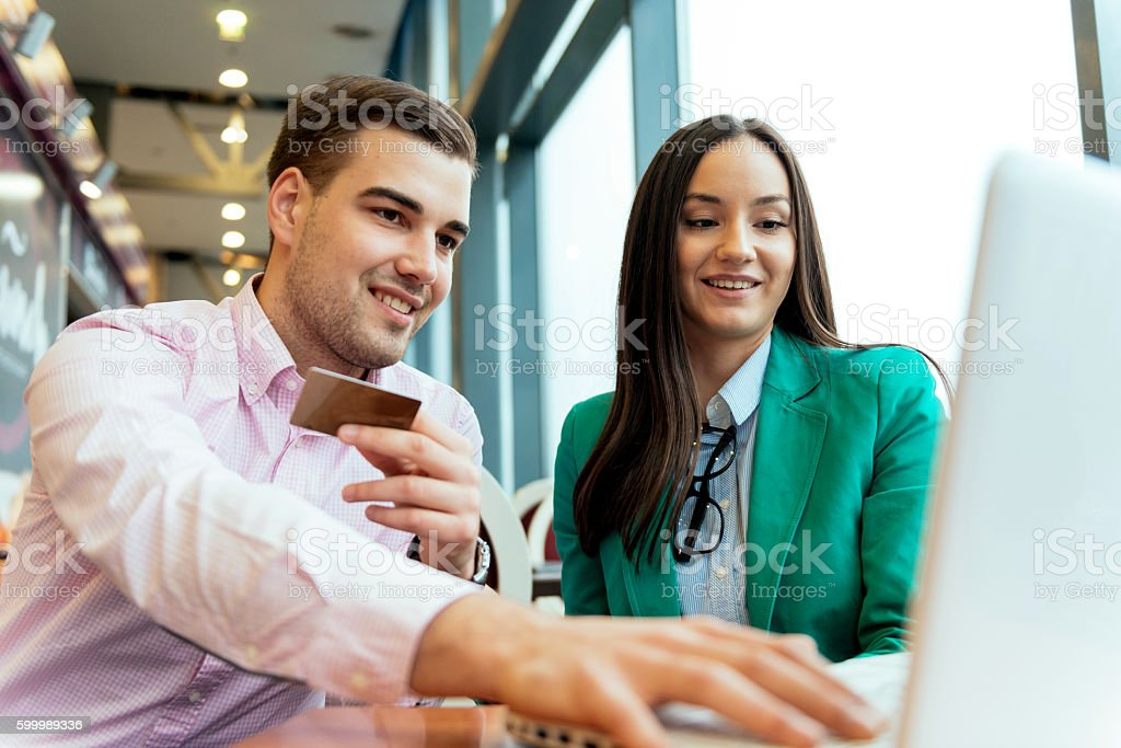 Couple enjoying buying items online stock photo