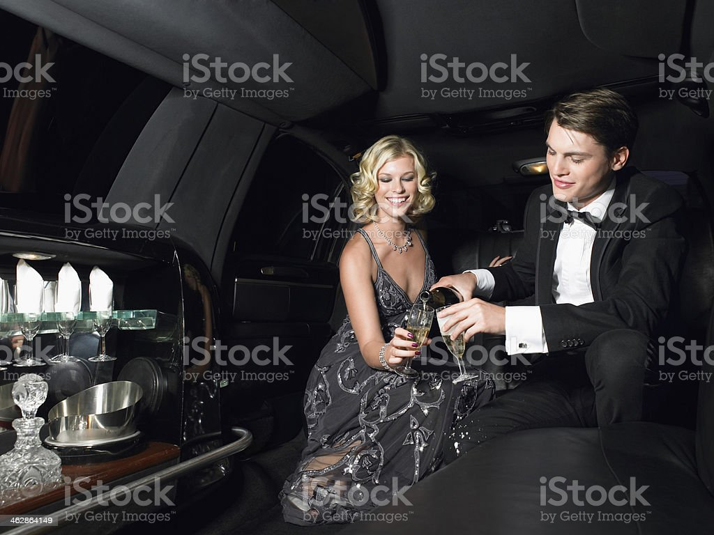 Couple Enjoying Champagne In Limousine stock photo