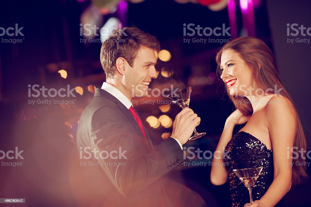 couple enjoying coctails stock photo