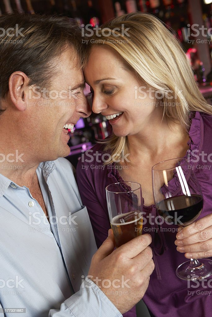 Couple Enjoying Drink Together In Bar royalty-free stock photo