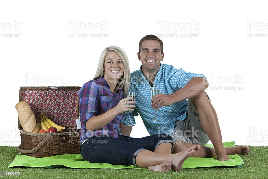Couple enjoying drinks at picnic royalty-free stock photo
