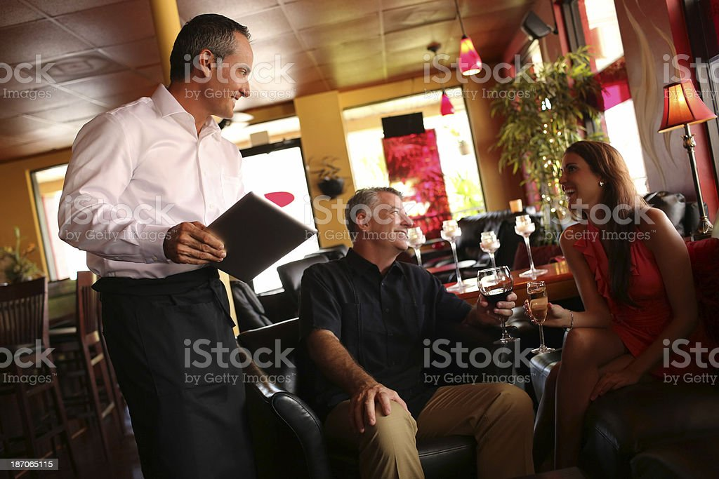 Couple Enjoying Drinks In Restaurant royalty-free stock photo