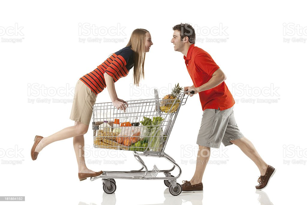 Couple enjoying each other's company while shopping royalty-free stock photo