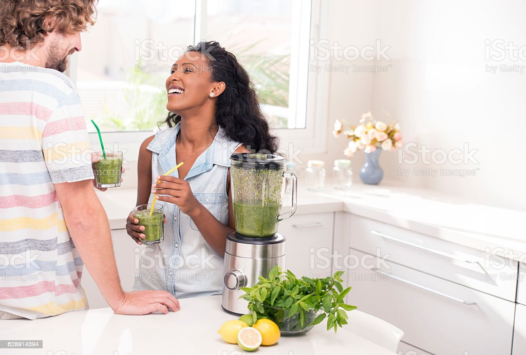 Couple enjoying fresh drink. stock photo