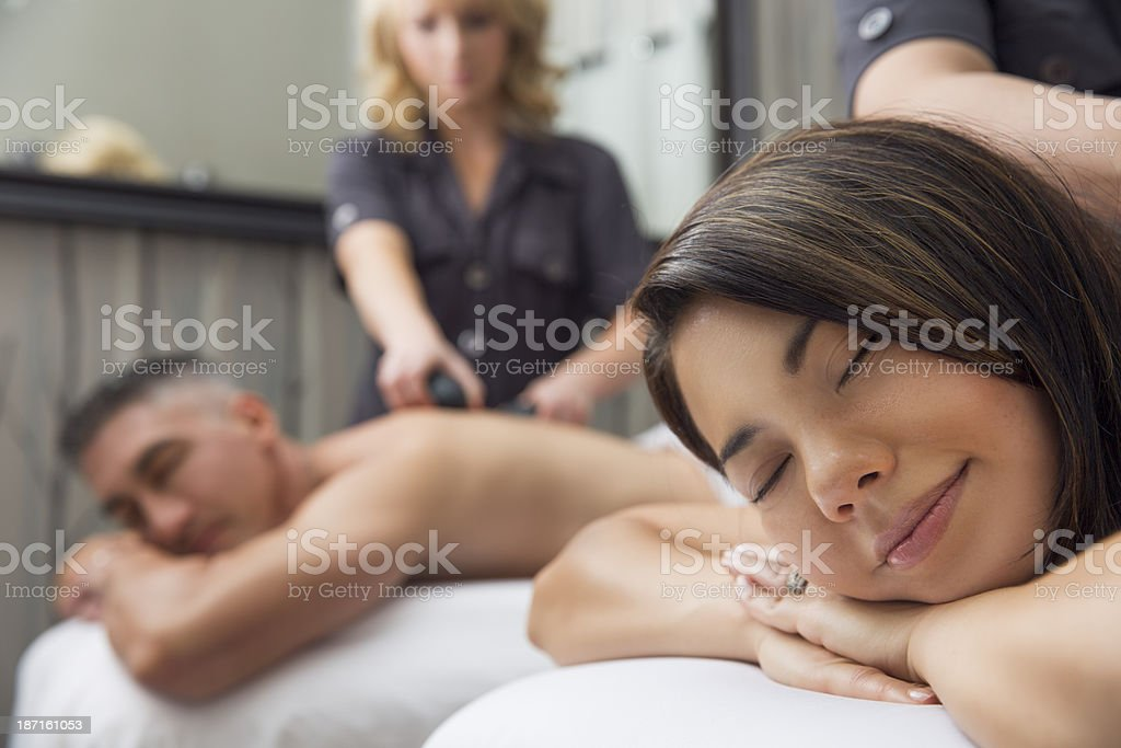 Couple enjoying hot stone massage at the spa royalty-free stock photo