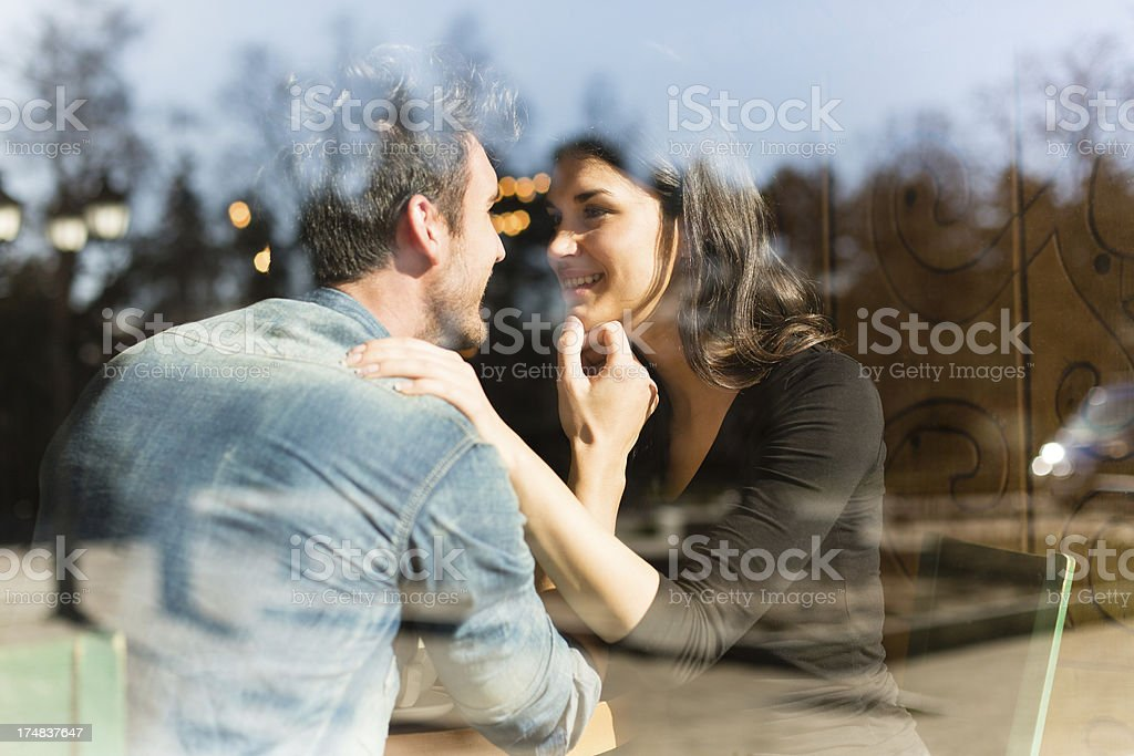 Couple enjoying in a cafe royalty-free stock photo