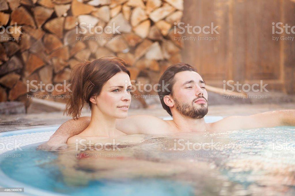 Couple enjoying in a hot tub stock photo
