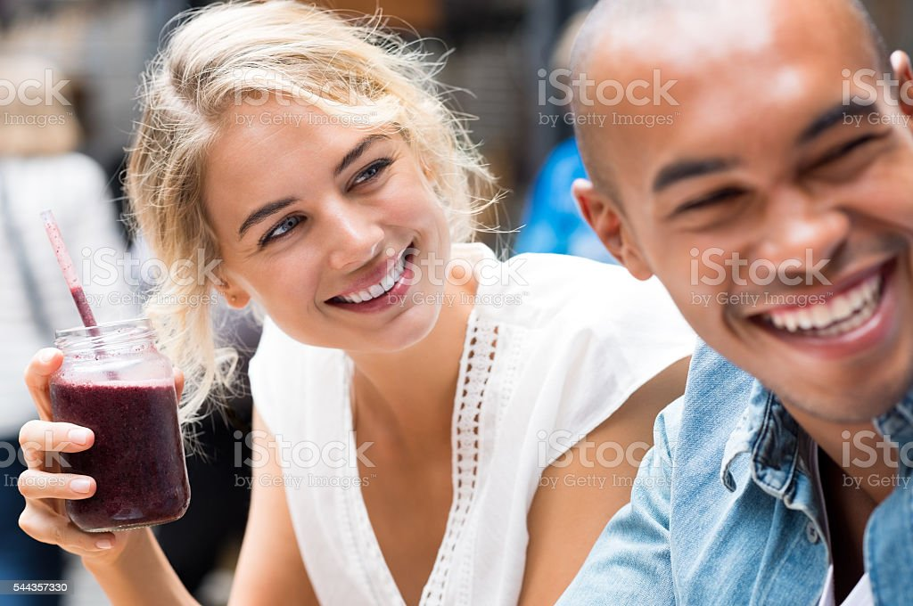 Couple enjoying in café stock photo