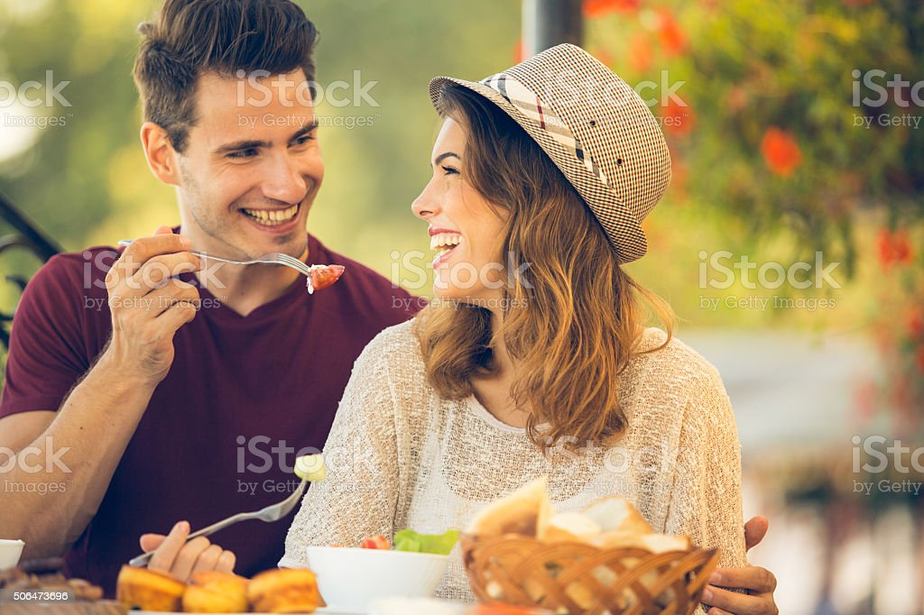 Couple enjoying lunch at a restaurant stock photo