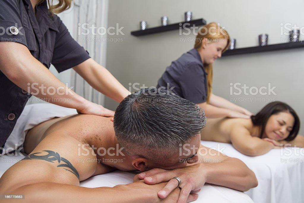 Couple enjoying massage treatment at the spa royalty-free stock photo