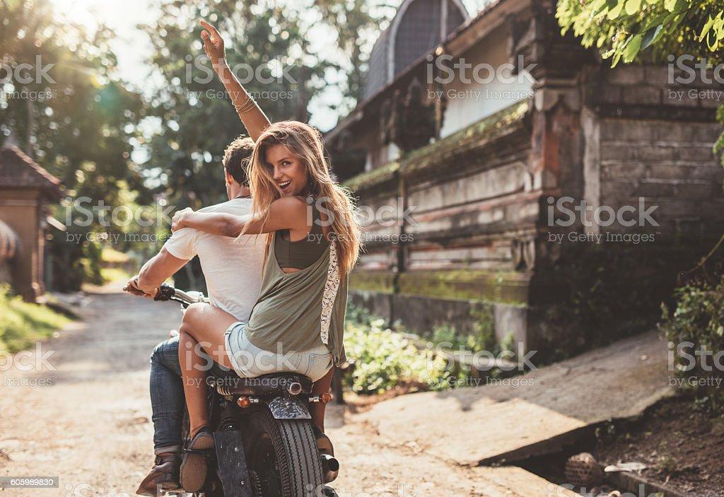 Couple enjoying motorcycle ride on village road stock photo