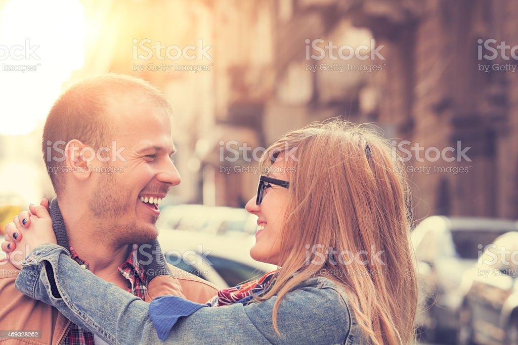 Couple enjoying outdoors in a urban surroundings. stock photo