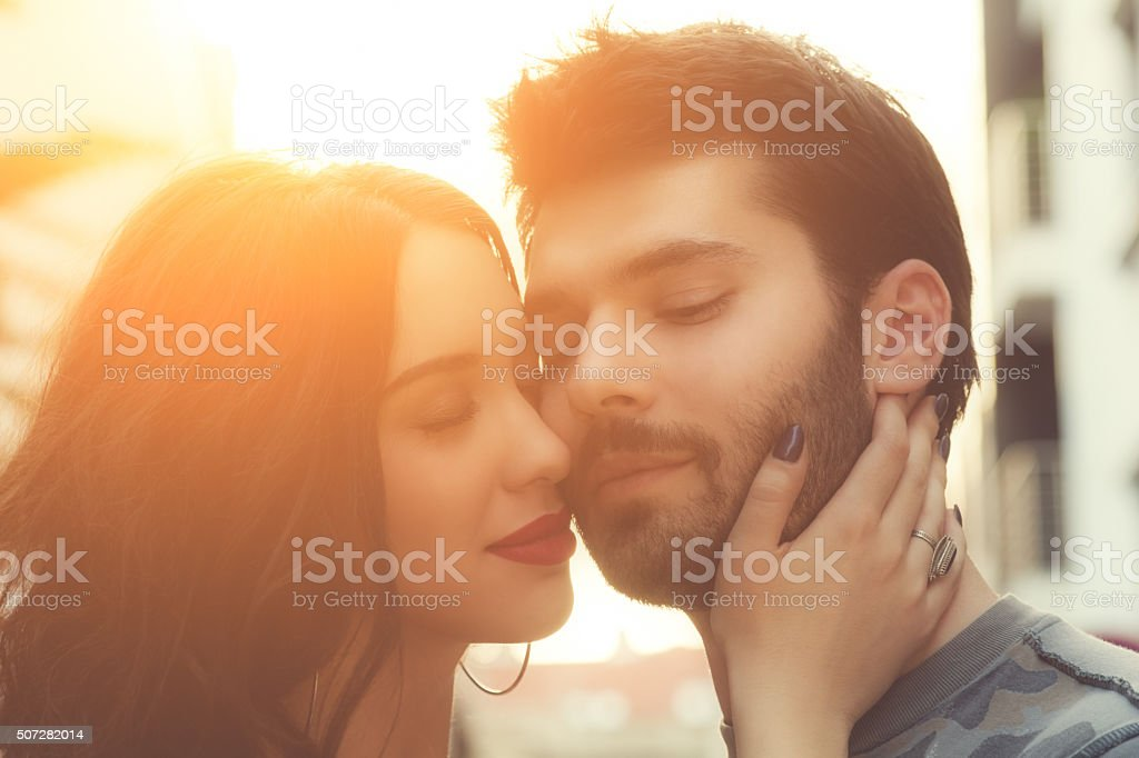 Couple enjoying outdoors in a urban surroundings. stock photo