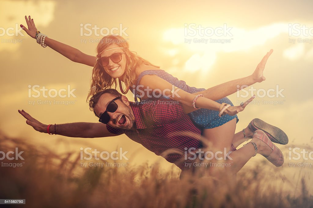 Couple enjoying outdoors in a wheat field. stock photo
