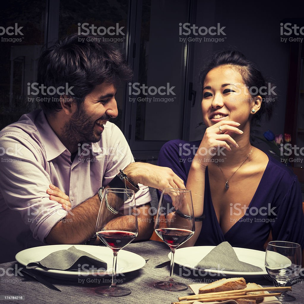 Couple enjoying red wine on Valentine's Day stock photo