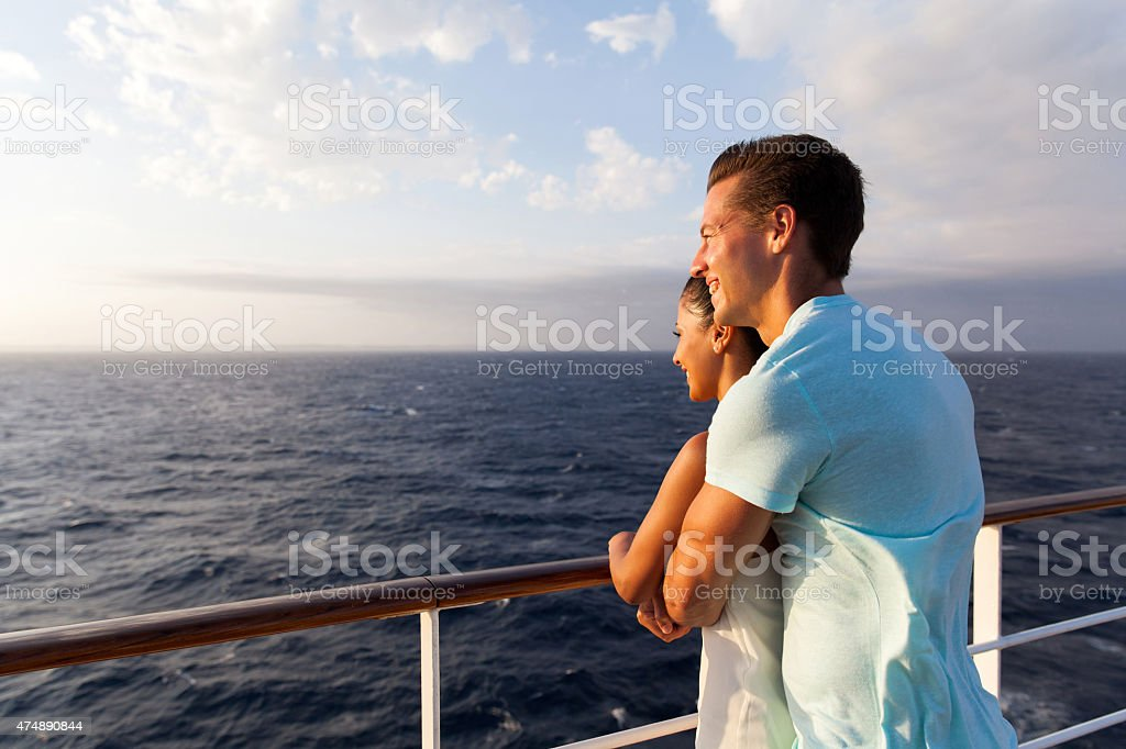 couple enjoying sea view in the morning stock photo