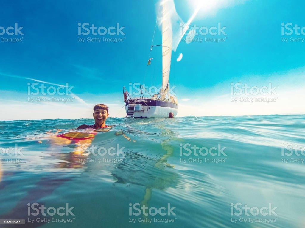 Couple enjoying summer holidays on a sailing ship stock photo