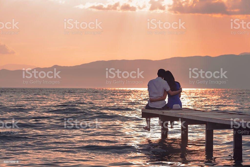 Couple Enjoying Sunset stock photo