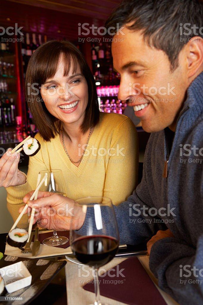 Couple enjoying sushi together in restaurant royalty-free stock photo