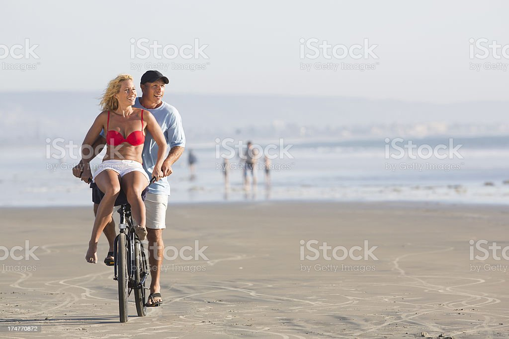 Couple enjoying the beach royalty-free stock photo