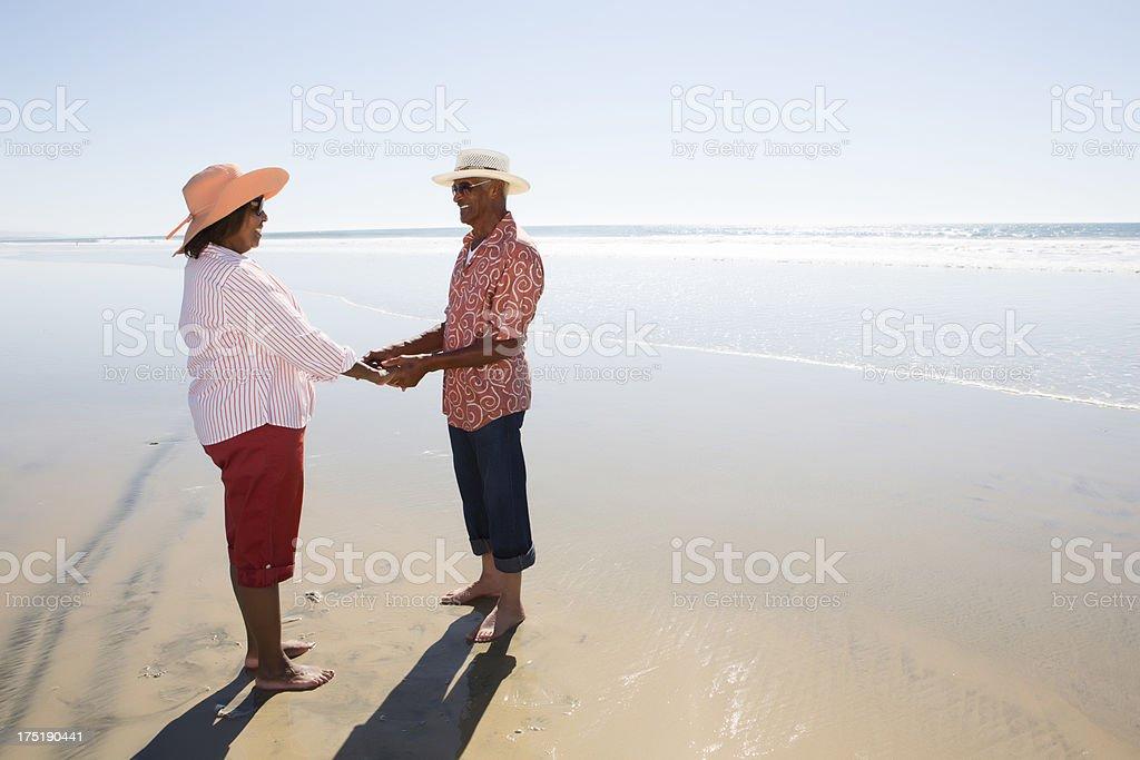 Couple enjoying the beach stock photo