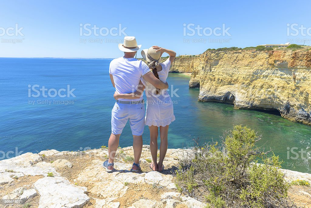Couple enjoying the ocean view from a cliff stock photo