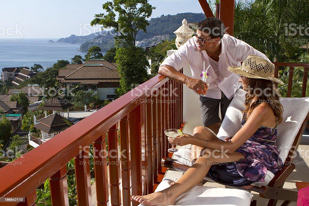 Couple enjoying the sea view from a balcony royalty-free stock photo