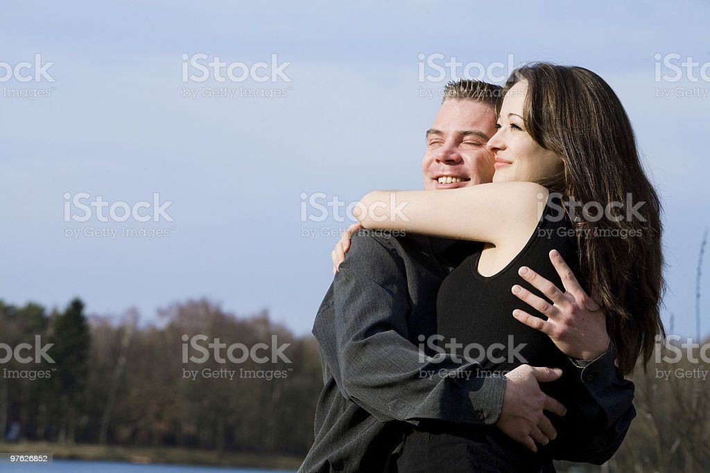 Couple enjoying the sunlinght royalty-free stock photo