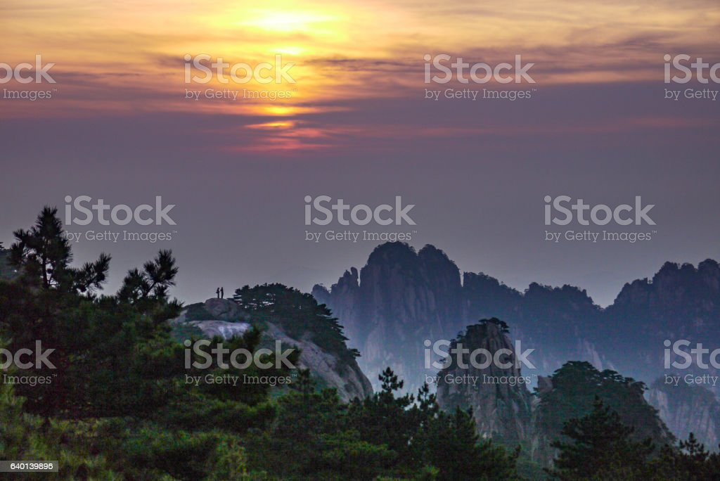 Couple enjoying the sunset light over the Huangshan mountains, China stock photo